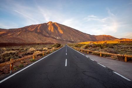 island: Straight road on Teide park with volcano on background on Tenerife island Stock Photo