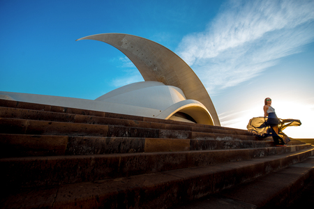 santa cruz de tenerife: SANTA CRUZ DE TENERIFE, SPAIN - DECEMBER 17, 2015: Auditorio de Tenerife in Santa Cruz de Tenerife with woman walking. This auditorium was designed by famous architect Santiago Calatrava