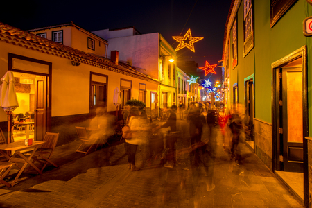 Night street view in La Laguna town with Christmas illuminated decoration and blurred people on Tenerife island in Spain Stock Photo