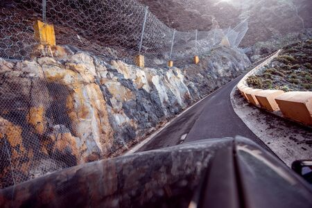 dangerous road: Dangerous road with landslide to the cape of Teno on Tenerife isalnd Stock Photo
