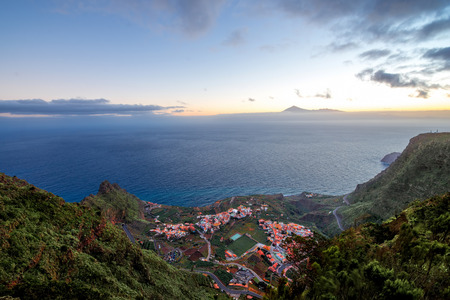 Top view from Mirador de Abrante on Agulo coastal village with Tenerife island on background on La Gomera island on the sunrise in Spain Stock Photo