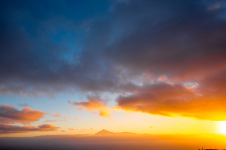 beautiful sunshine: Beautiful seascape view with Tenerife island contour and clouds on the sunrise in Spain Stock Photo