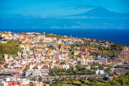 Top view on San Sebastian city the capital of La Gomera island with Teide volcano on the background Stok Fotoğraf
