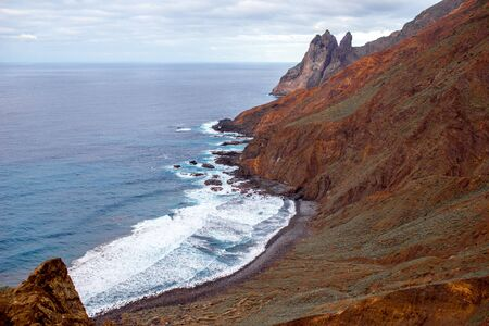 western part: Rocky coastline with stone beach on the western part of La Gomera island near Arguamul village in Spain