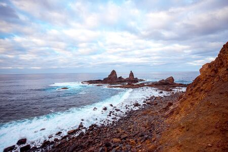 western part: Rocky coastline with sharp cliffs in the ocean on the western part of La Gomera island near Arguamul village in Spain Stock Photo