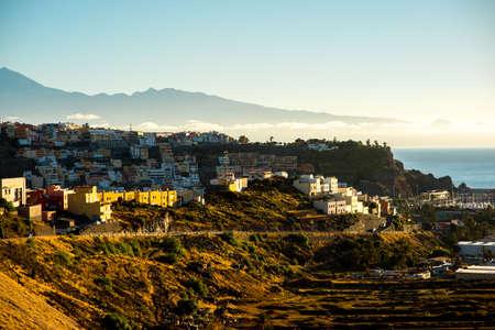 san: San Sebastian cityscape view on La Gomera island with Tenerife island on the background on the morning