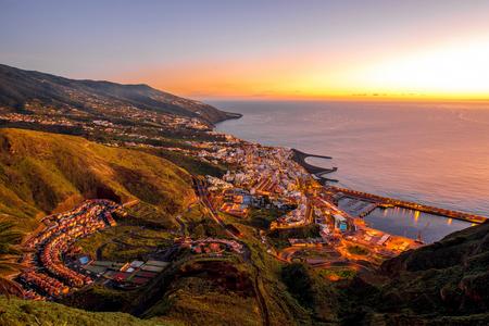 santa cruz: Aerial view on illuminated Santa Cruz city on the dusk on La Palma island in Spain Stock Photo