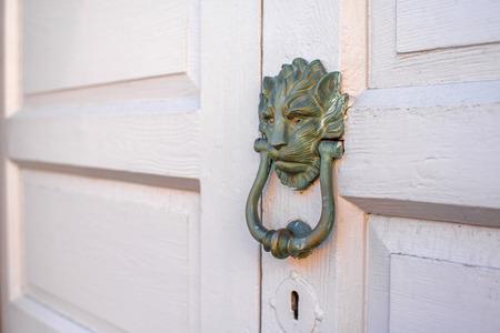 santa cruz: Old handle on the wooden door in Santa Cruz de la Palma city in Spain. Architectural detail close-up view.