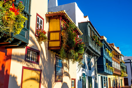 Famous ancient colorful balconies decorated with flowers in Santa Cruz city on La Palma island in Spain Stock Photo