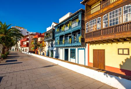 santa cruz: Famous ancient colorful balconies decorated with flowers in Santa Cruz city on La Palma island in Spain Stock Photo