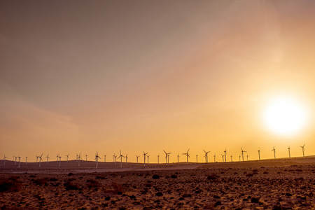 turbina: Electric windmills on the south of Fuerteventura island on the Jandia desert. Wide angle view with copy space