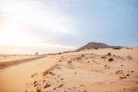 corralejo: Desert road on Corralejo dunes on Fuerteventura island in Spain Stock Photo