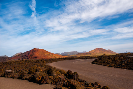 capes: Volcanic landscape near Los Hervideros capes on Lanzarote island in Spain Stock Photo