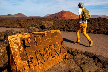 los hervideros: Man walking to Los Hervideros landmark on Lanzarote island