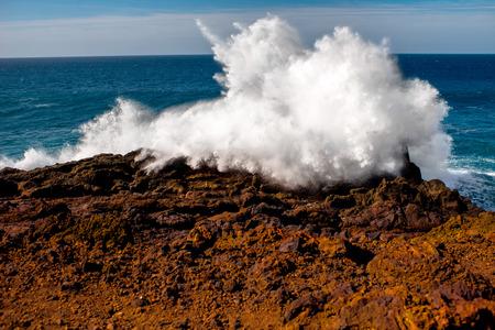 los hervideros: Huge ocean splash on the rocky Los Hervideros coast on Lanzarote island in Spain Stock Photo