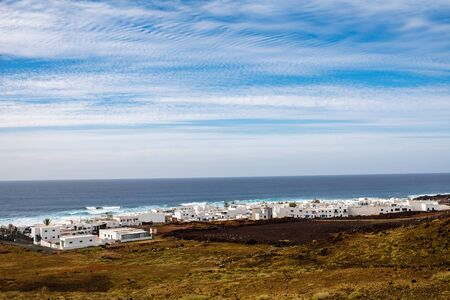 golfo: Cityscape view on El Golfo village with white houses on Lanzarote island in Spain