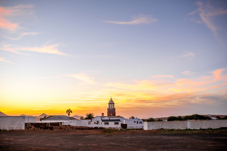 touristic: Wide angle view on Teguise village with church tower on the sunset on lanzarote island