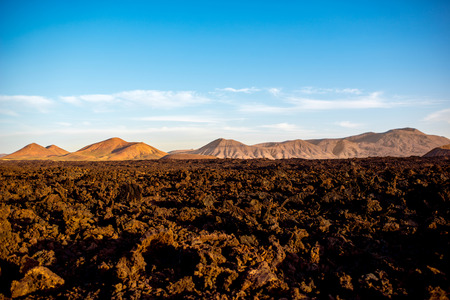Volcanic landscape near Los Hervideros capes on Lanzarote island in Spain Stock Photo