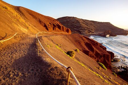 golfo: Footpath to El Golfo bay on the sunset on Lanzarote island in Spain Stock Photo