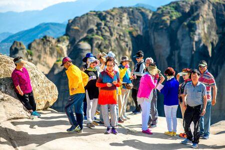 kalabaka: KALABAKA, GREECE - CIRCA JUNE 2015: Korean group of tourists visit Meteory monasteries in Kalabaka village in Greece Editorial