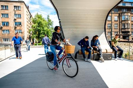 sarajevo: SARAJEVO, BOSNIA - HERZOGOVINA - CIRCA JUNE 2015: People on Festina Lente bridge in Sarajevo. Festina Lente is a looping bridge in Sarajevo designed by three Bosnian students. Editorial