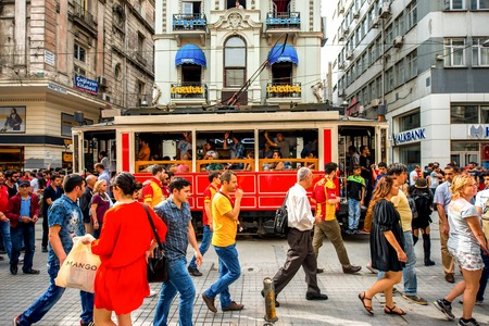 avenues: ISTANBUL - MAY 28, 2015: Crowded Istiktal avenue with tram in the Pera region in Istanbul. Istiktal avenue is one of the most famous avenues in Istanbul, visited by nearly 3 million people in a day Editorial
