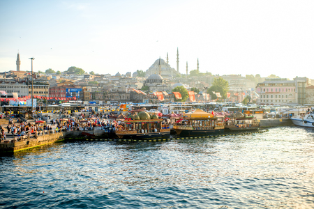 eminonu: ISTANBUL - MAY 28, 2015: Golden Horn coast and near Galata bridge with popular turkish buffet on boats with fish sandwiches. This place is very famous with lots of restaurants and street foods.