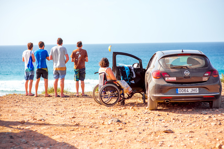 rented: EL COTILLO, FUERTEVENTURA ISLAND, SPAIN - SIRCA JANUARY 2016: Group of people travel by car rented at Cicar company on Fuerteventura island. Cicar is very popular car rental company on Canary islands