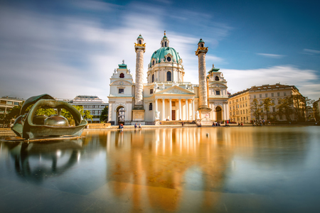 technic: View on st. Charless church on Karlsplatz in Vienna. Long exposure technic with blurred clouds and glossy water