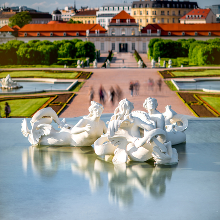 technic: Fontain sculptures in Belvedere with lower castle and blurred people on the background. Long exposure technic