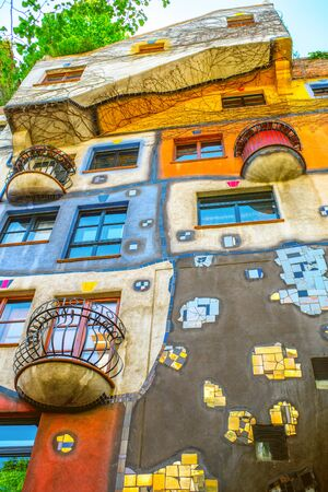 expressionist: VIENNA, AUSTRIA - CIRCA APRIL 2016: Colorful apartment house  in Vienna named Hundertwasserhaus. This building is famous expressionist landmark designed by artist Friedensreich Hundertwasser Editorial