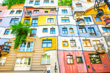 residential building: VIENNA, AUSTRIA - CIRCA APRIL 2016: Colorful apartment house  in Vienna named Hundertwasserhaus. This building is famous expressionist landmark designed by artist Friedensreich Hundertwasser Editorial