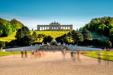 gloriette: VIENNA, AUSTRIA - CIRCA APRIL 2016: Gloriette building in Schonbrunn gardens. This Palace is one of the most important historical monuments in Austria. Long exposure technic with blurred people