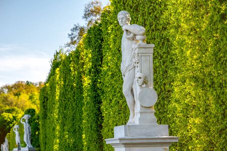 schonbrunn palace: VIENNA, AUSTRIA - CIRCA APRIL 2016: Schonbrunn gardens with statues in Vienna. Schonbrunn palace is one of the most important architectural and historical places in Austria