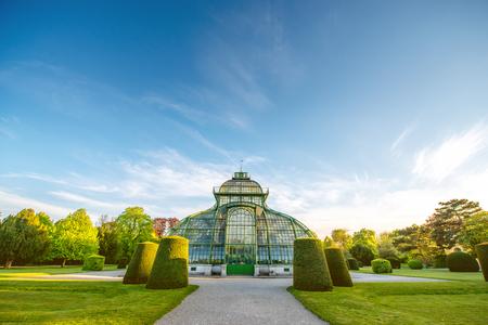schloss schoenbrunn: VIENNA, AUSTRIA - CIRCA APRIL 2016: Palmenhaus in Schonbrunn gardens in Vienna. This greenhouse is the largest botanical exhibits of its kind in the world