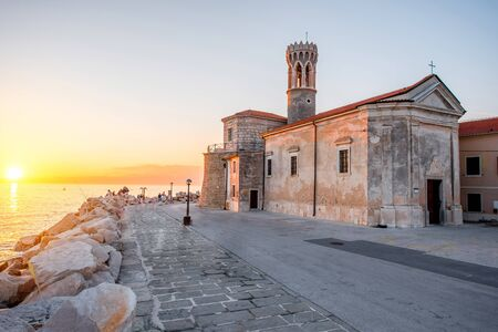 clement: Madona cape with saint Clement church in Piran town at the sunset in Slovenia