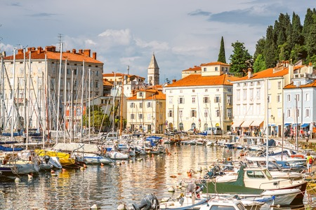 old center: Piran, Slovenia - May 7, 2016: Piran old town center with church tower and marina. Piran is one of Slovenias major tourist attractions. Editorial