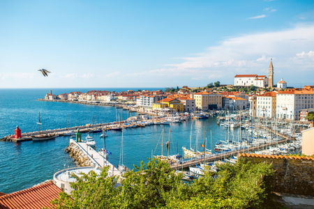 top 7: Piran, Slovenia - May 7, 2016: Top view on the gulf of Piran with old town center on the Adriatic sea. Piran is one of Slovenias major tourist attractions.