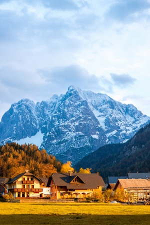 snowed: Beautiful landscape with village and snowed up mountains near Triglav national park in Slovenia. Traveling slovenian Alps
