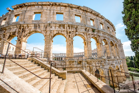 Architectural fragment of ancient roman amphitheatre in Pula city in Croatia. Banco de Imagens