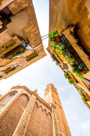 View from below on basilica dei Frari and houses in Venice Stock Photo