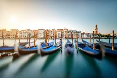 campanille: Venice cityscape view on Grand canal with colorful buildings, gondolas and San Marco campanille at the sunset. Long exposure image technic with motion blurred boats and glossy water