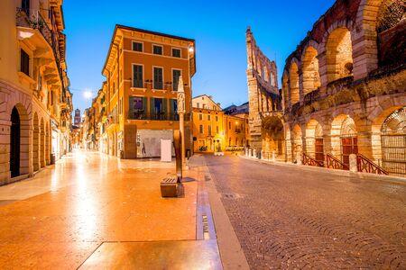 Night view on illuminated Bra square with Arena in Verona city
