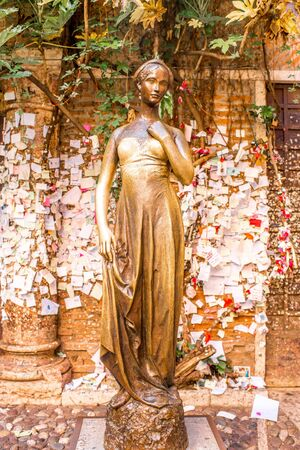 tragedy: Verona, Italy - May 22, 2016: Juliet statue in Verona city. Romeo and Juliet is a tragedy written by William Shakespeare.