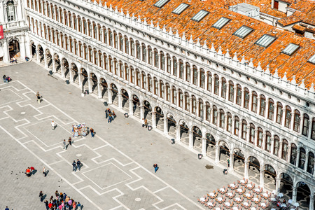 procuratie: Venice, Italy - May 18, 2016: Top view on San Marco square crowded with tourists. This square is the most popular place among tourists in Venice