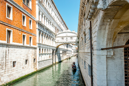 gondolier: Venice, Italy - May 18, 2016: Gondolier sail on gondola in water canal near the bridge of Sighs in Venice. Editorial