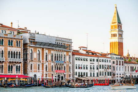campanille: Venice, Italy - May 18, 2016: Sunset view on San Marco campanille with gothic buildings on Grand canal in Venice