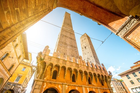 Two famous leaning towers Garisenda and Asinelli in Bologna city. Bolognas two leaning towers are the citys main symbol Stock Photo