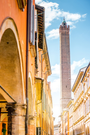Street view with famous Asinelli tower in Bologna city in Italy. Bolognas two leaning towers are the citys main symbol Stock Photo