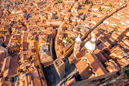 Aerial cityscape view from the tower on Bologna old town with Garisenda tower and roman catholic church Stock Photo - 61796932